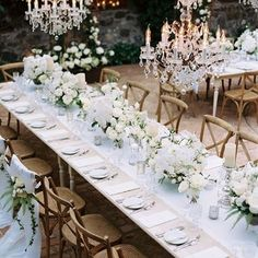 We love the enchanted atmosphere of this all-white wedding at Haiku Mill in Maui! Simple centerpieces of white blooms and greenery paired with striking crystal chandeliers set a stylish, yet relaxed feel over the tablescape. #BBinspirationfix #welove #whitewedding #destinationwedding #luxurywedding  Photographer: @leopatrone | Venue: @haikumill | Event design & planning: @alison_events | Florals: @teresasenamaui