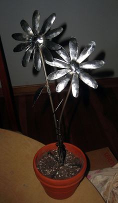 Steel Flowers, by S. Marchio by MillerWelds.com, via Flickr