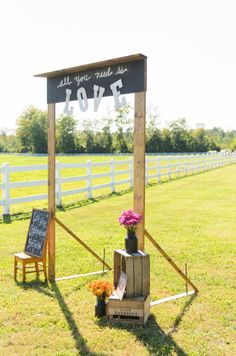 amazing wooden arch entrance to the reception: all you need is love
