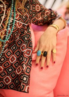 Vintage pattern + red nails + gold rings with big stones.