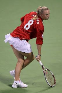 Outside The Match: Caroline Wozniacki In Stella McCartney Adidas pleated tennis skirt.