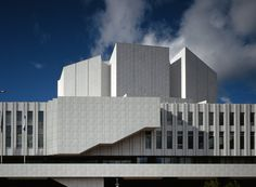 Finnlandia Hall is a centerpiece of the Finnish capital of Helsinki, boasting a towering auditorium and high roof, curving balconies, and an exterior of white marble and black granite. #dwell #moderndesign #modernarchitecture