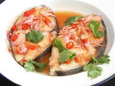 Thai-Style Sweet and Sour Steamed Fish | Serious Eats : Recipes. She simmers