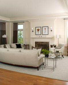 Living Room   Benson Interiors -Boston, Ma  www.bensoninteriors.com #livingroom #interiordesign #greycarpet #sofa #fireplace #chair #offwhite #windowtreatments #sconces #floorlamps #sidetables #woodfloor