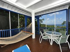 The screened in porch of RoseBay is a great place to unwind and relax. #GreatCruzBay #CaribbeanVillas