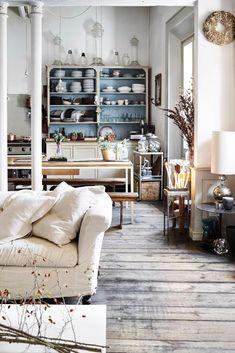 Hardwood floor, light walls, pop of color kitchen hutch. | Stylish Italian Apartment.