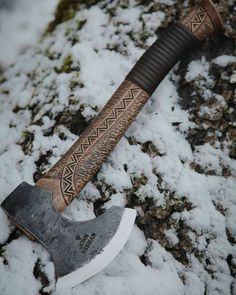 Custom made Little Elf's axe with leather inlay and Scandinavian ornaments on the handle. #axe #handmade #carving #axes #outdoors #forester #carvings #camp #camping #wild #wildlife #wilderness #carpenter #woods #woodworking #bushcraft #handforged #vikings #smith #forge #blacksmith #scandinavia #scandinavian #neemantools by neemantools