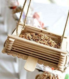 Relive those summer-camp memories of crafting with popsicle sticks. This birdseed bin features a ton... - Courtesy tonyastaab.com