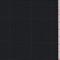 Black, teal green, pumpkin and mulberry plaid.This lightweight wool/rayon fabric has a soft feel.Compare to $15.00/yd