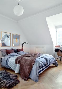 Lovely bedroom with a bed from Hästens and beautiful textiles in blue colors.