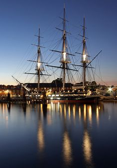 Boston Night Photography image of the historic USS Constitution battleship by New England award winning based fine art photographer Juergen Roth. The Old Ironsides is mooring in the Charlestown Navy Yard in historic Boston, Massachusetts and twilight paints the details of this beautiful tall ship. Photograph was taken at twilight on a beautiful summer night in June 2014.  Good light and happy photo making!  My best,  Juergen www.RothGalleries.com www.ExploringTheLight.com