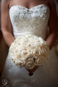 Classic elegance! Ivory roses with crystal accents and delicate white stephanotis.