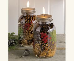 Clean-burning oil candles infused with decorative pinecones, pine needles and holly berries all sealed up inside mason jars. Pot Mason Diy, Mason Jar Crafts, Oil Candles, Mason Jar Candles, Candels, Floating Candles, Beeswax Candles, Scented Candles, 242