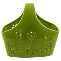 """Ceramic basket with laser-cut fleur detail in glossy green.   Product: BasketConstruction Material: CeramicColor: GreenFeatures:  Charming designWill enhance any dcor Dimensions: 14"""" H x 16"""" W x 10"""" DCleaning and Care: Wipe with dry cloth"""