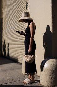 Proportion: big hat, tiny bag