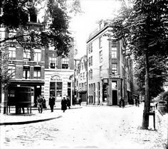 """1930. A view of the Lindengracht in the Jordaan neighborhood of Amsterdam. In the center the entrance to the Tichelstraat and on the right the Lijnbaansgracht. On the left, a public urinal also called a """"Krul"""". At the corner of Lindengracht and Tichelstraat café J. Peeters. The Lindengracht is one of six Jordaan canals that were filled-in 120 years ago. On Saturday's the street is reserved for a general market. Photo Stadsarchief Amsterdam / Nico Swaager. #amsterdam #1930 #Lindengracht…"""