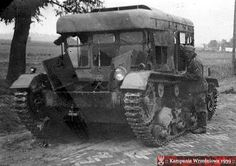 """A German soldier examines an abandoned """"Klara"""" Polish artillery tractor. September 1939 - pin by Paolo Marzioli Mechanical Engineering, Armored Vehicles, World War Two, Military Vehicles, Wwii, Tractors, Abandoned, Axis Powers, Model"""