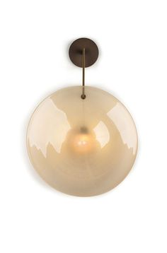 The Orbe Wall Sconce in Murano glass with gold leaf creating both a majestic color and unique texture within the glass.