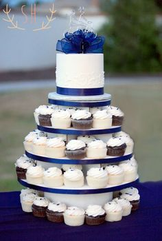 cupcake tower, blue and white theme, bicycle topper  Wedding Cake | Sarah Hummert Photography www.sarahhummertphoto.com