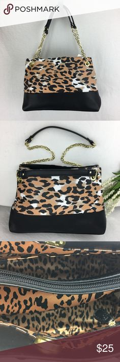 New Animal Print handbag with gold chain strap New with partial tag attached.  Never used.  Purchased for a gift, but I never gave it.   Can carry with both handles for a 8.5 inch drop from your shoulder, or (as seen in photo #2) you can carry the bag with only one strap so that it drops 15 inches from your shoulder.     Height:  9.5 inches Length:  14 inches Depth:  6 inches  Interior has 2 slit pockets and one zipper pocket on the interior side and one center zippered compartment.  This is…
