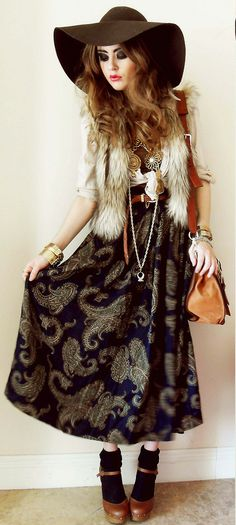 very cool look. I love the pattern of the dress with the fur vest. + the hat