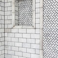 view full size. Fantastic shower features white marble subway tile surround accented with black grout ...