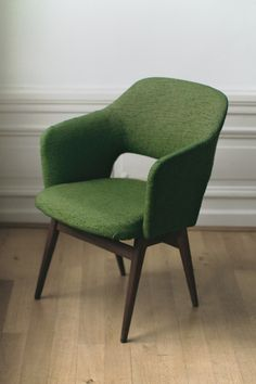 moss green tweed upholstered chair.