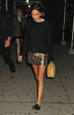 Her own style rules: She teamed the short number with shiny black loafers and a unique handbag in the other
