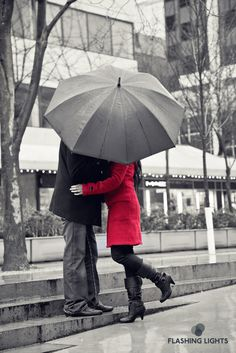 #engagement: Stealing a #kiss under the #umbrella! #love #red #black and #white #eshoot #photography #flphotodesign