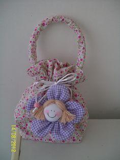 Bolsa de tecido para criança confecbolsos y carteras cionada em qualquer estampa/cor. Confira nosso mostruário e escolha o tecido desejado.