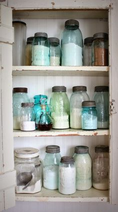 Shabby chic wall cupboard and a collection of old jars