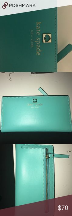 Kate Spade aqua blue wallet In great condition, it's a aqua turquoise color on the outside. kate spade Bags Wallets