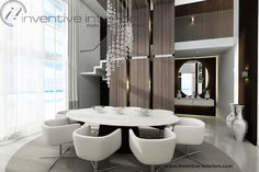 Projekt domu z widokiem Inventive Interiors - wysoka jadalnia z długim żyrandolem