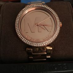 FINAL PRICE DROP !Micheal Kors watch Rose gold Micheal Kors watch great condition comes with the box! Comes with extra links as well! The band has a few stratches but not noticeble Michael Kors Accessories Watches