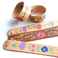 Leather cuffs, wood burning tool and some paint is all you need to make these bracelets.