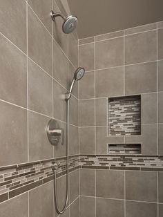 This Shower Has Beautiful Neutrals And A Splash Of Bling With The  Decorative Tile Liner And Built In Shampoo Niche.