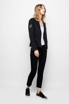 Zadig & Voltaire military jacket with patches and embroidered customization. Quilted polyester lining. 100% cotton.
