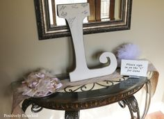 sign a big wooden letter with baby's initial for guestbook at baby shower, guest book idea, hang in room later