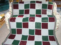 """My first full size afghan was this Heirloom Sampler Afghan.  Each 8"""" square was a different stitch.  It was a GREAT way to teach myself how to read pattern instructions!  The picture does not do it justice since it doesn't show the detail of each square but they are all different."""