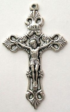 Loreto crucifix.  I don't know why this design is called a Loreto Crucifix, my best guess is that it is patterned after one in the shrine of Our Lady of Loreto in Loreto Italy