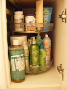 Use a lazy susan under the bathroom sink for organizing bath & body products.  This would be great under a kitchen sink, too.  To organize all those cleaners that get everywhere.