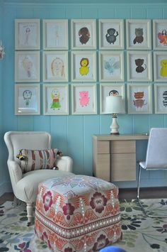Best art for your walls... stuff your kids create. I like how the frames give it an orderly look, but retains the sentimentality