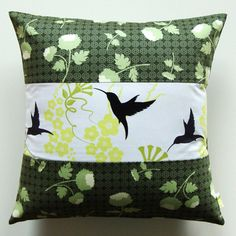 Flora and Fauna Fabric by Patty Young, not sure who made the pillow. :(
