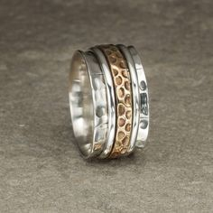 silver and bronze karma spinning ring by charlotte's web | notonthehighstreet.com