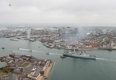 Entering port: HMS Diamond is led into the Portsmouth Harbour by two Royal Navy patrol vessels HMS Raider and HMS Blazer after firing a 21 gun salute which was answered by the navy saluting gun over the harbour entrance