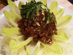 Yukhoe or Yookhwe 육회, Korean style beef steak tartare recipe - Maangchi.com. You need fresh filet minon (tenderloin) or fresh beef flank steak, Korean pear (I think this is Asian pear), soy sauce, honey, sesame oil, garlic, ground black pepper, salt, sugar, roasted sesame seeds, and pine nuts. Top it off with a raw egg yolk!