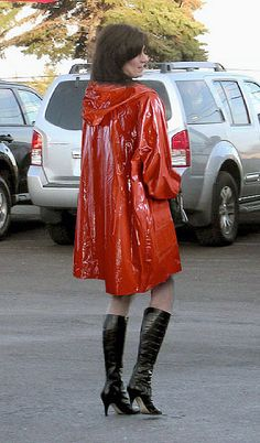 Dressed for a rainy day in her short red pvc mac