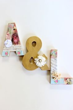 Using a variety of cardstock easily create DIY Mod Podge vintage initial letters to be used at an engagement party, wedding decor and also home decor.