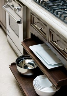 Sliding shelves for easy access to cooking essentials ~