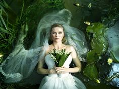 Justine as Ophelia, in the opening sequence of images in 'Melancholia'